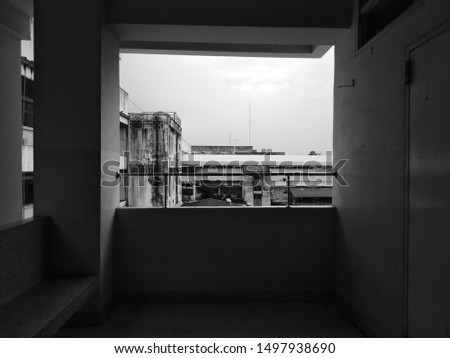 The black and white photo on the balcony are beautiful, overlooking the buildings and the sky. Let the feeling of loneliness, loneliness and loneliness.  #1497938690
