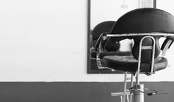 The black chair in beauty salon, gray tone.