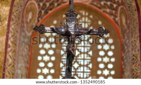 The black cross in the altar of the cathedral in Palermo Sicily Italy along with the saints on the altar infront of the church