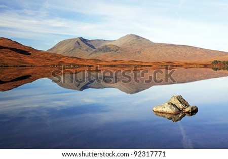 The Black mount mountain range on a very calm day. Just as all the mist lifted it revealed this mirror image on Loch Ba, Rannoch moor.
