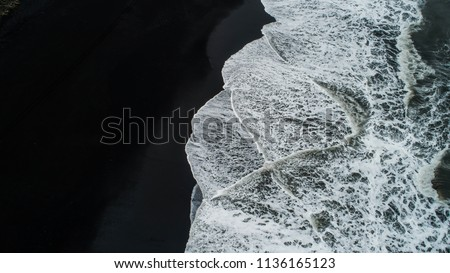 The black sand beach in Iceland. Sea aerial view and top view. Amazing nature, beautiful backgrounds and colors. #1136165123