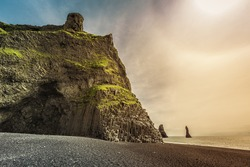 The black sand beach of Reynisfjara near Vik with light leak, Iceland
