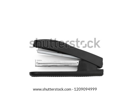 The black stapler used in the office to manually connect paper