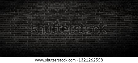 The black wall surface uses a lot of bricks. Or old black brick wall abstract pattern. Put together beautifully dark background.