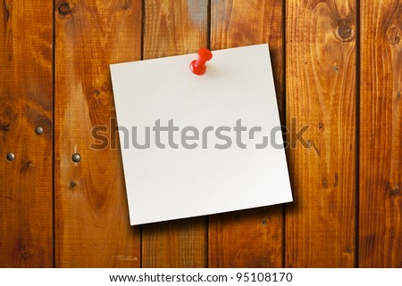 the blank paper note on wood board background