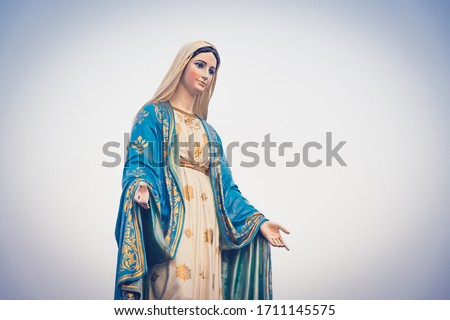 The blessed Virgin Mary statue figure in a sunset time. Catholic praying for our lady - The Virgin Mary. Stock fotó ©