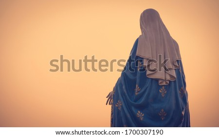 The blessed Virgin Mary statue figure in a warm tone - sunset scene. Catholic praying for our lady - The Virgin Mary. Stock fotó ©