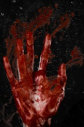 The bloody hand on the wet glass, the bloody window, an imprint of bloody hands, zombie, demon, killer, horror