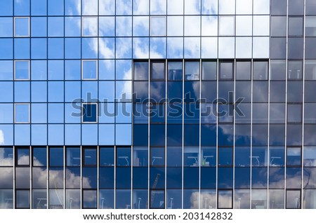The blue and glass facade with equal vertical lines