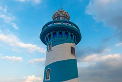 The blue and white lighthouse on top of Santa Ana hill and Las Penas district, Guayaquil, Ecuador.
