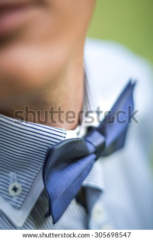 the blue bow tie on the groom
