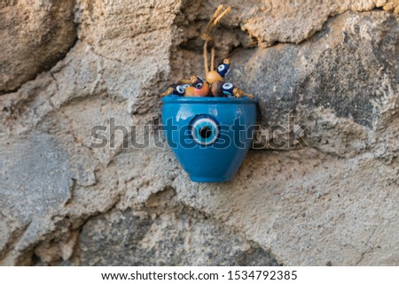 the blue charm stone ornament on the wall