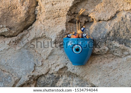 the blue charm stone ornament on the wall,place for writing
