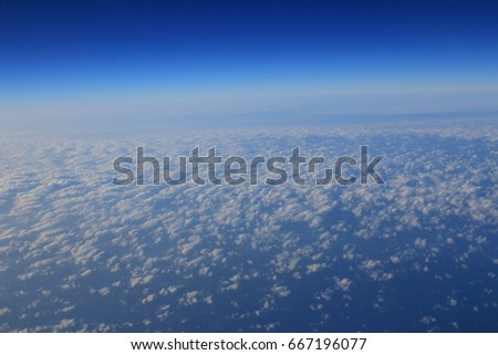 the Blue Cloud was taken on a plane for background #667196077