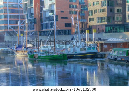 The blue ice on the canal in Hafencity Hamburg.Springtime in reflections. #1063132988