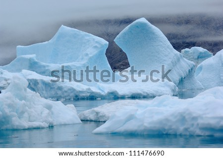 The Blue Icebergs of Narsarsuaq Greenland originating from the Qooroq Glacier - stock photo