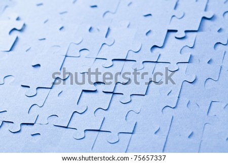 the blue jigsaw puzzle background - stock photo