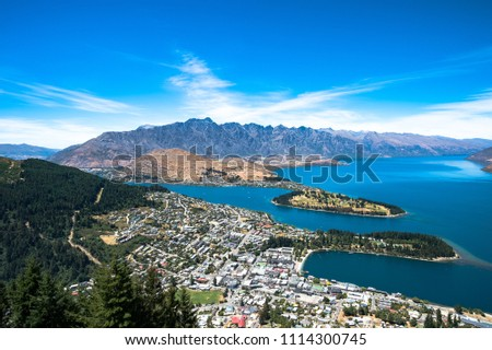 The blue lake and clear sky with beautiful town view from Skyline Gondola, Queenstown, New Zealand #1114300745