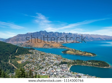The blue lake and clear sky with beautiful town view from Skyline Gondola, Queenstown, New Zealand #1114300766