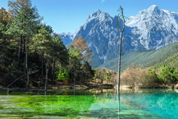The blue moon valley of Yulong Mountain in Yunnan province, China. The water is extremely clear and shows blue color.