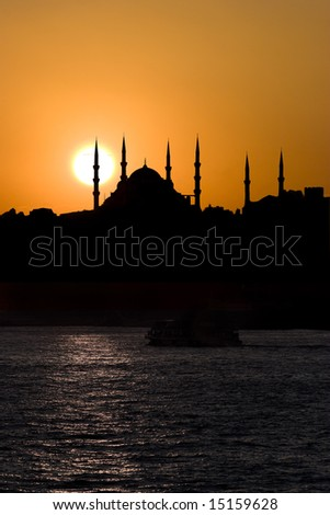 The Blue Mosque and sunset from the sea in Istanbul Turkey