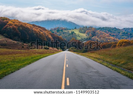 The Blue Ridge Parkway and fog over mountains in Virginia. #1149903512