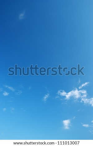 The blue sky and white clouds.