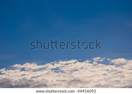 The  blue sky  with clouds.