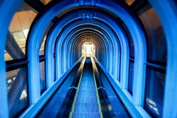 The blue tunnel light escalator of Umeda Sky building, The One of tourist popular landmarks in Osaka city.