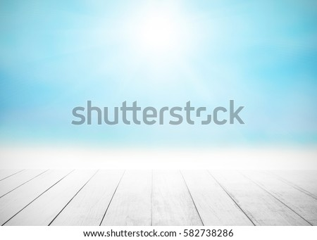 Shutterstock The blur cool sea background with wood floor foreground on horizon tropical sandy beach; relaxing outdoors vacation with heavenly mind view at a resort deck touching sunshine, sky surf summer clouds.