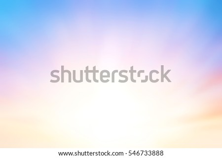 The blur pastels gradient sunset background on soft nature sunrise peaceful morning beach outdoor. heavenly mind view at a resort deck touching sunshine, sky summer clouds. #546733888