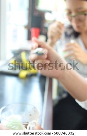 The blur view of customer eat ice cream