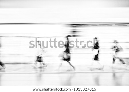 The blurred image of asian people in the station  rush time for train subway station