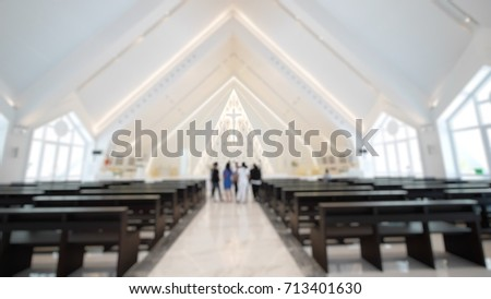 The blurred picture is the public church in Thailand. The picture concepts are church, architecture, thanksgiving, christian.