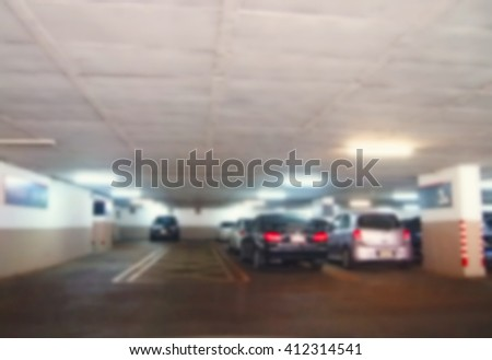 The blurry focus of indoor car park building through the car windscreen represent the car parking concept related idea. #412314541