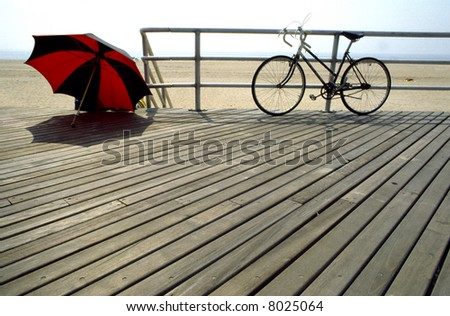 The boardwalk at Coney Island in New York with sun shade and bike