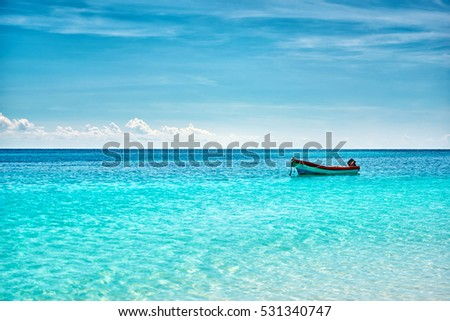 The boat in the Caribbean Sea on a sunny day. Clear water. #531340747