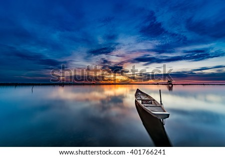 The boat speeding toward the sun as if to hold back the light at sunset like A arrow shooting in the sky sunset. This picture was taken in Pha Tam Giang Lagoon, famous lagoon in Hue, Viet Nam ,Travel
