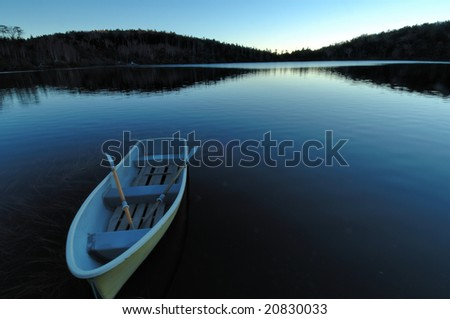 The boat which floats in the shore of the daybreak