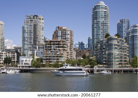 The boats and high rise buildings of the False Creek neighborhood of Vancouver, British Columbia.