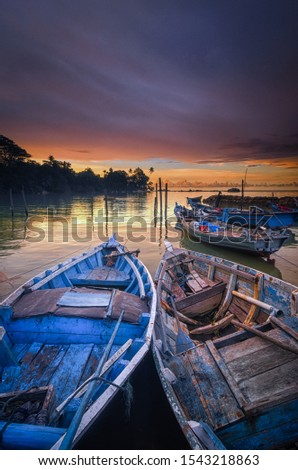 the boats and the twilight sky