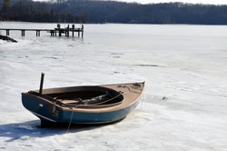 The Body of a Bluish-Green Sailboat Frozen in the Severn River