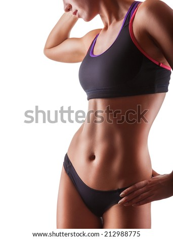 Stock Photo The body of a young athletic girl isolated on a white background