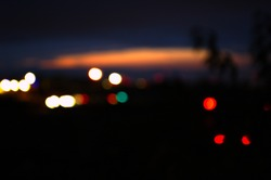 The bokeh effect of streetlights at dawn in London.