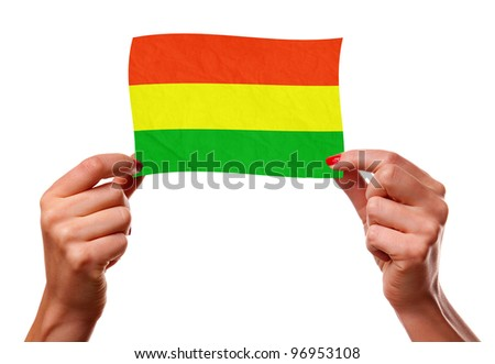 The Bolivian flag in the woman hands. closeup