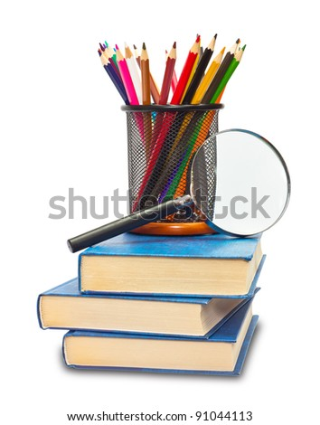 The books pencils, and magnifying glass on white