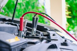 The booster cables and discharged battery, Charging car battery with electricity trough jumper cables