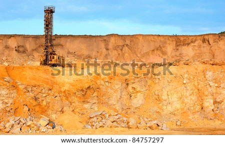 The boring car against sand open-cast mine