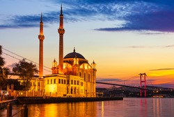 The Bosphorus bridge at sunrise near the Ortakoy Mosque, Istanbul, Turkey