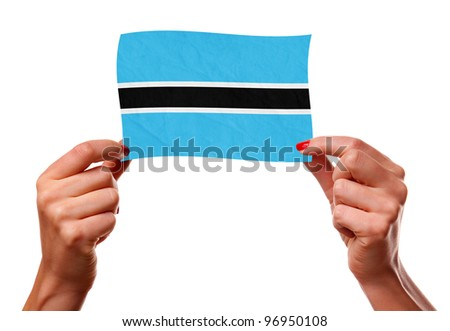 The Botswana flag in the woman hands. closeup - stock photo